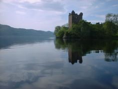 Scotland - Loch Ness with Urquhart Castle nestled on its banks.   (And no Nessie to be seen anywhere!)
