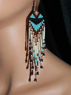 "Beautiful Handcrafted Turquoise, Copper, Bronze, White, Black and Genuine Porcupine Quills in appx. 4-1/2"" Long Beaded Earrings. These are so Beautiful with their Silver Ear Wires make these a beautiful pair of Wearable Art. Highly Recommended for anyone who wants to add color to their wardrobe and wants a great combination of color for any Native American Dance function and powwow. You will not be disappointed !!"