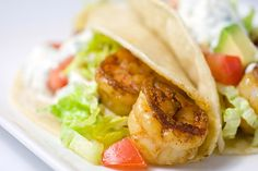 Yummy Shrimp Tacos!   The Cilantro Lime Sour Cream is to die for.