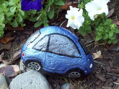 Shiny Blue VW Volkswagen Bug...A painted rock...looks like her little blue one, her first one she had....