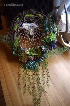 Succulent Dream Catcher Grapevine Wreath by TheSleepingSirens on Etsy https://www.etsy.com/listing/533006228/succulent-dream-catcher-grapevine-wreath