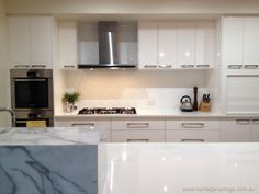 Look what an incredible job can be done by a DIY person using a couple of sheets of pressed metal. It is a budget priced splashback that looks as if it cost a million dollars Pressed Metal, Kitchen Cabinets, Tin Panel, Kitchen, Home, Cabinet, Splashback, Home Decor, Garage Studio