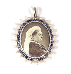 An enamelled gold 'Queen Victoria' pendant by Carlo Giuliano   in the form of an oval enamel portrait of Queen Victoria, taken from a photograph, mounted in a black and white enamel border, surrounded by pearls. English, circa 1880