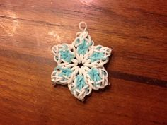 Snowflake based on the Rainbow Loom Hibiscus Flower design. I made the middle X in light blue and the border in white with an extra 6th petal. The link for the hibiscus is: http://m.youtube.com/watch?v=2Z4_Jx4v7To&feature=share&desktop_uri=%2Fwatch%3Fv%3D2Z4_Jx4v7To%26feature%3Dshare