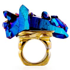 Ice On Fire Ring  by Andy Lifschutz Jewelry    < Return to Andy Lifschutz        $320fab        $428 retail price      Size      Quantity      Add to Cart    Not for the faint of heart: the jagged, iridescent crystals of the Ice On Fire Ring form a dramatic cluster atop a sizeable bronze band.