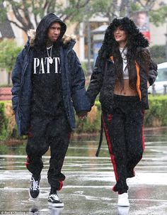 Can't rain on their love parade! Kylie Jennerwas spotted hand-in-hand with her beau Tyga, 27, as they headed to the mall in Calabasas on Saturday