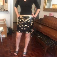 Gold and black Geometric Sequin skirt! I lost weight so it doesn't fit me anymore! Like new. Perfect for a night in an upscale night club :) ILOVE Skirts Mini