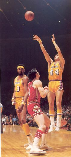 Jerry West shoots over Jerry Sloan