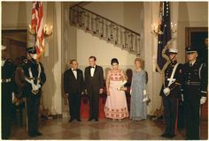 President and Mrs. Nixon and President Josip Broz Tito and Mrs. Tito, in black tie, enroute to a dinner in President Tito's honor