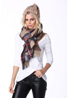 A great scarf perfect for the upcoming cold seasons. This scarf has a tartan design throughout an...
