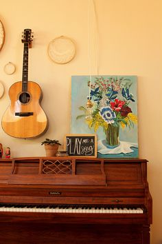 Hang guitars and banjo over piano to conserve floor space