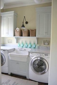 small laundry room... I like the style and length of these cabinets... I would take the molding to the ceiling and instead of a shelf I would add a hang bar