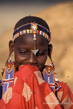 Africa | A young Masai woman, wearing large ear-flaps.  Near Amboseli National Park.  Kenya | ©Christine and Michel Denis Huot