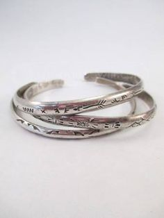 Old pawn Navajo Sterling cuffs.