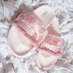 Fuzzy pink Puma slides