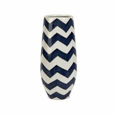 Imax Corp 25103 Chevron Short Vase by IMAX. $49.70. Material Ceramic. Length 8. Height 15.75. Chevron is a classical graphic pattern getting an updated push with new color combinations. The blue and white zigzags on this vase make a strong statement, whether displayed prominently on the shelf, used to decorate the patio, or filled with a large bouquet of fresh flowers.. Save 24%!