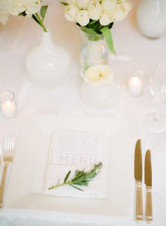 all white table setting + minimalist menu