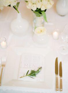 all white table setting + minimalist menu