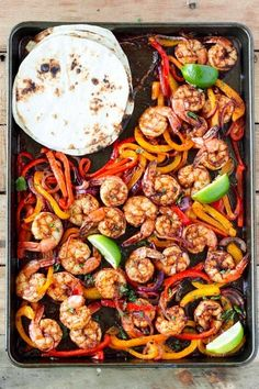 Sheet Pan Shrimp Fajitas - - This shrimp fajita recipe is so easy and delicious. With juicy shrimp, tender bell peppers and onions its the perfect easy weeknight dinner! Clean Eating Recipes For Dinner, Clean Eating Snacks, Paleo Dinner, Shrimp Fajita Recipe, Shrimp Fajitas, Clean Eating For Beginners, Anti Inflammatory Recipes, Supper Recipes, Eating Clean