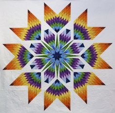 it's the sashing that makes it! Tulip Star pattern by Eric Gunsonpiecefulexpressions