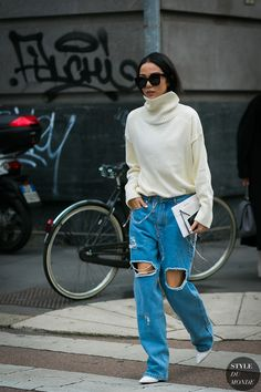 Milan Fashion Week Fall 2017 #StreetStyle: Yoyo Cao in ripped jeans and oversized ivory sweater