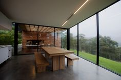 Tassie home - love the wood, concrete, black frames, maple tree & outside fireplace