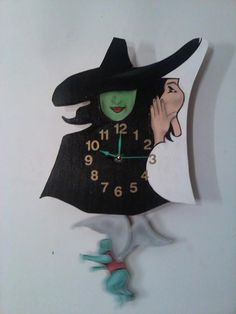 "No need to Defy Gravity here!! This wonder pendulum clock is handcrafted and painted signed by the artist Inspired by the Broadway hit musical ""Wicked"". Flying monkey swings to clock movement. Actual"