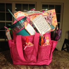 """Bag from Thirty-one filled with things a girl may need for college. I attached tags to each item with a fun little thing on them. Example: flip flops, """"dorms are gross, always wear shoes!""""."""