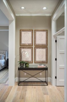 cool Mirrored console, curated prints, transom, floors... by http://www.best99homedecorpictures.us/transitional-decor/mirrored-console-curated-prints-transom-floors/