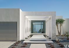 Geometric purity prevails at a Los Angeles businessman's house renovated by Magni Design. The entry colonnade frames the hilltop view while routing visitors across a cantilevered footbridge over a reflecting pool. Minimalist House Design, Minimalist Architecture, Modern Architecture House, Minimalist Home, Modern House Design, Architecture Design, Landscape Architecture, Landscape Design, Architectural Digest