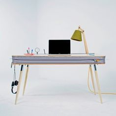 Oxymoron Desk by Anna Lotova stores  stationery between cushioned layers
