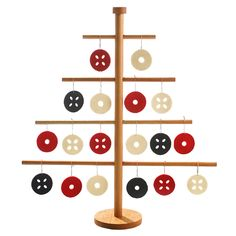 Verso Finland. Christmas tree candleholder. Wool felt cut out decorations. Top with lighted candle.