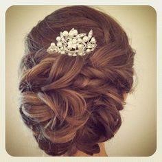 bridal hair updo low bun with jeweled comb