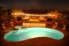 Market Lights strung across the backyard for night time swimming... Someday...
