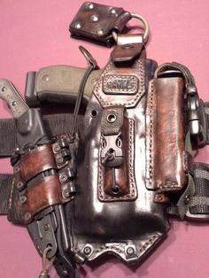 "ATL Araphel Tactical Leather holsters. They have a sort of ""steampunk"" appearance but at the same time it also looks like it could get easily snagged on something with all those rings and loops. ATL..."