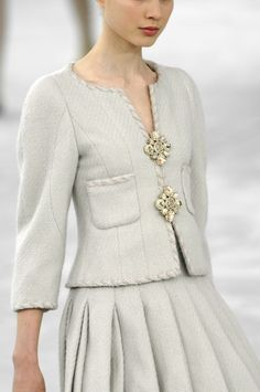 #chanel chic.. but a couple of large brooches would look great on any jacket.