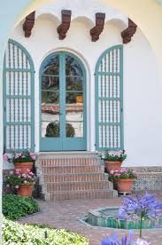 Andalusian designs: tile, water features, court yards - Blue arched shutters