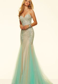sweetheart neckline, mermaid style, corset, added bustle, strapless, ombre nude into teal with beaded accents. Size 12