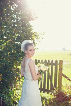 Bird Cage Veil and Lace Wedding Dress. Cute key charm for the bouquet