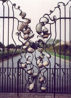 Stone within iron gate - prickly pear sculpture Tor Design, Gate Design, Metal Gates, Wrought Iron Gates, Metal Screen, Garden Gates, Garden Art, Rocks Garden, Garden Entrance