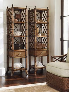Leather-wrapped rattan and decorative latticework show an island-inspired, Polynesian influence on this sophisticated shelf tower. A functional as well as fashionable storage piece, you can use the etagere doubled up or singly in the corner of your office, bedroom, living room, or mud room. Features four open storage shelves, one drawer for closed storage, and elegant antiqued metal finals crowing the rattan posts.