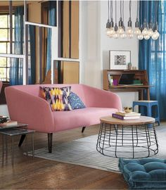 Best Bargain Buys: 10 Stylish Sofas Under $1000 - I love the mirror arrangement behind the sofa.