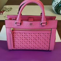 Kate Spade mini Romy Handbag Gorgeous Kate Spade Handbag in color caberet pink! A perfect bag for any occasion. Bag has one interior zipped pocket as well as two open interior pockets. Bag closes with a magnetic closure on top. Kate Spade logo is embossed in gold in the front of the bag as shown in first photo. Purchased for over 275.00 with taxes! Make me an offer! kate spade Bags