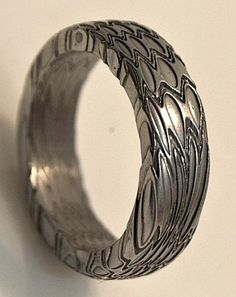 Stainless Damascus Wedding Ring Size 10.5. $235.00, via Etsy.