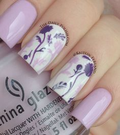 Pointer, pinky, and some of the floral design is China Glaze – Sweet Hook. The base white is Sally Hansen – Lavender Cloud and the darker purple is China Glaze – Grape Pop.