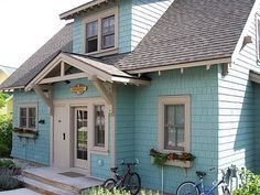 {bucket list item: must live in a cottage like this one day} small cottage, braced gable porch roof, window boxes, cedar shake siding, shed dormer, exposed rafters