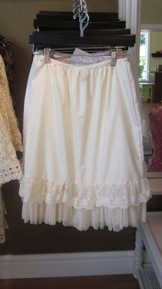 extender slip.  Sew some lace or ruffles onto slip to put under that skirt/dress I wish was just a little bit longer.  Genius!