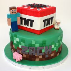 Minecraft cake - Both tiers are vanilla cake with vanilla buttercream covered in fondant. The tiles are all modeling chocolate (the greens are candy melt modeling chocolate). The man and the animals are gumpaste. The lettering is also modeling chocolate. Minecraft Party, Pastel Minecraft, Minecraft Birthday Cake, Birthday Cakes, Cake Minecraft, Minecraft Ideas, 9th Birthday, Birthday Ideas, Candy Melts