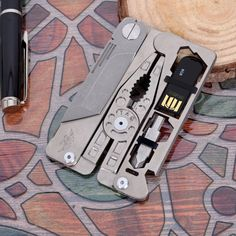 TAG - ultra lightweight pocket tool for everyday carry. The SUPRA a credit card shaped multitool that puts a tool box in your wallet.