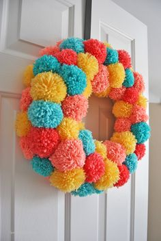 An Easy Colorful Pom Pom Wreath for Spring Learn how to make an easy colorful pom pom wreath for Spring, step by step at Sparkles of Sunshine.Learn how to make an easy colorful pom pom wreath for Spring, step by step at Sparkles of Sunshine. Wreath Crafts, Diy Wreath, Yarn Crafts, Door Wreaths, Yarn Wreaths, Tulle Wreath, Floral Wreaths, Burlap Wreaths, Crafts For Teens To Make